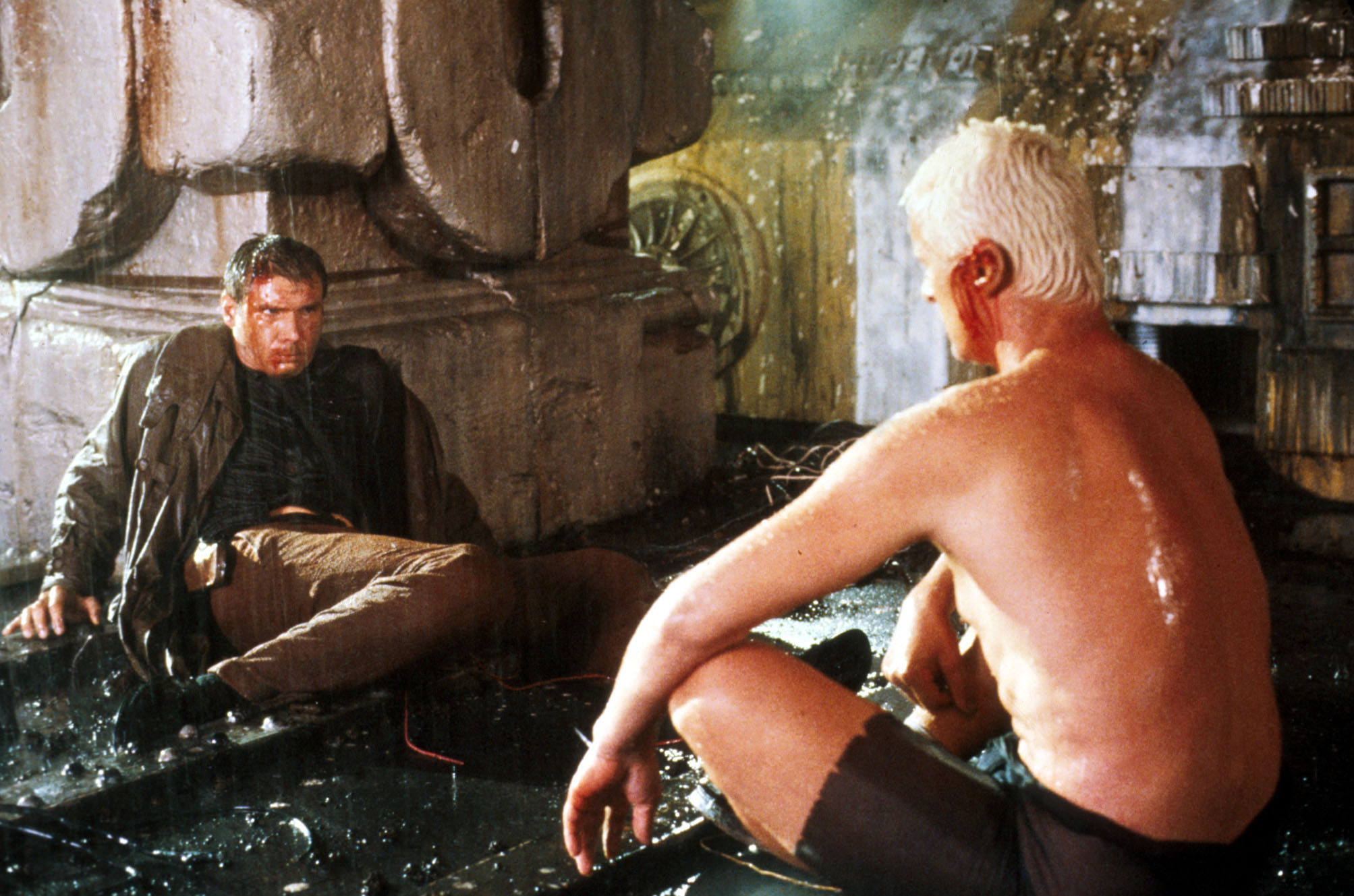 Deckard (Harrison Ford) and Replicant Roy Batty (Rutger Hauer) in the Ridley Scott film Blade Runner