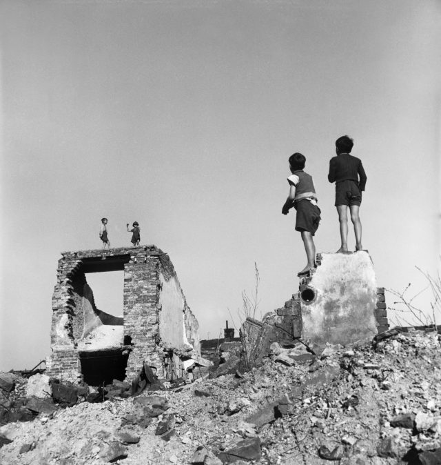 David Seymour - Boys play in bombed-out buildings. Vienna, Austria. 1948