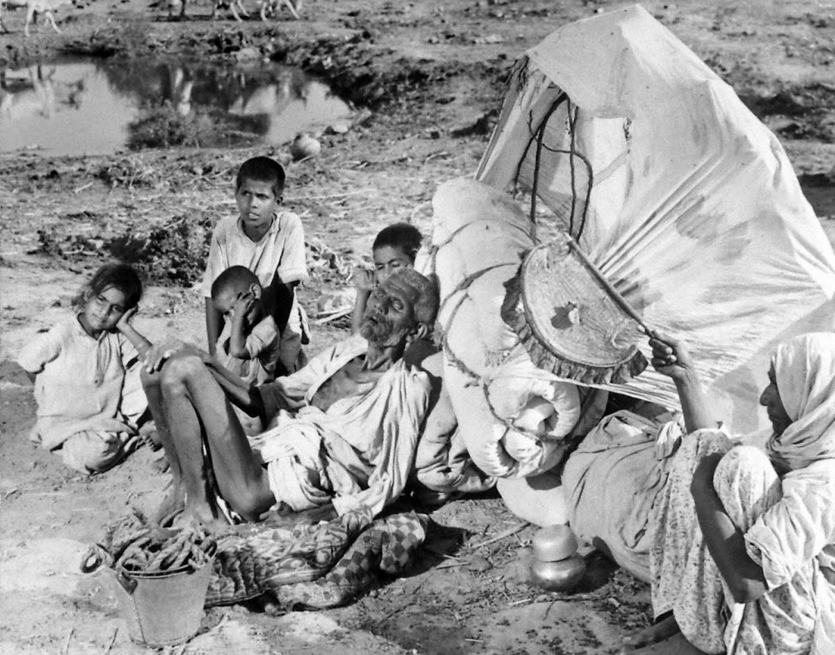 Abandoned at roadside because they were unable to keep up with caravan, this aged Moslem couple and their four grandchildren have little hope of survival