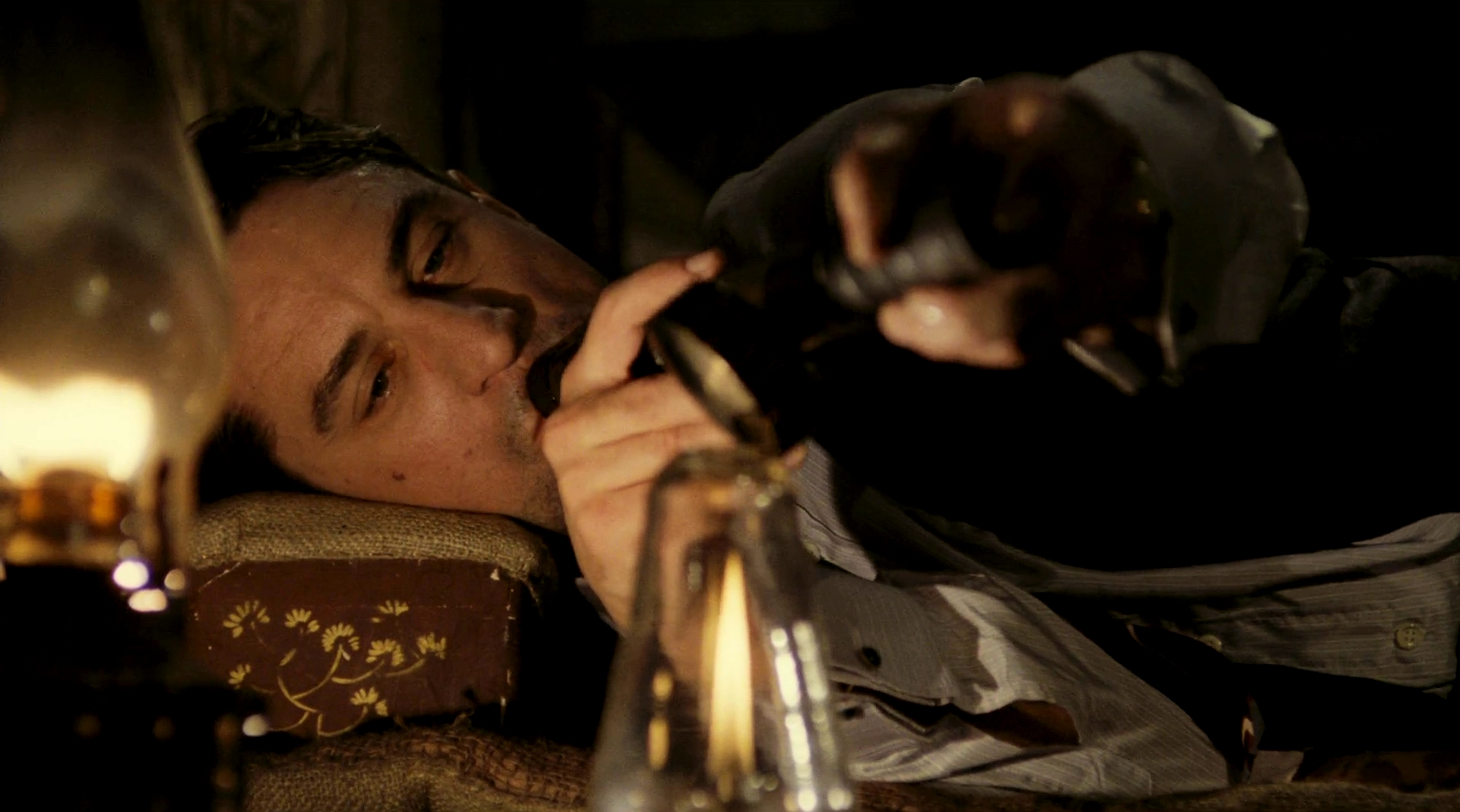 Noodles (Robert De Niro) takes a long draw on the pipe in the Chinese opium den