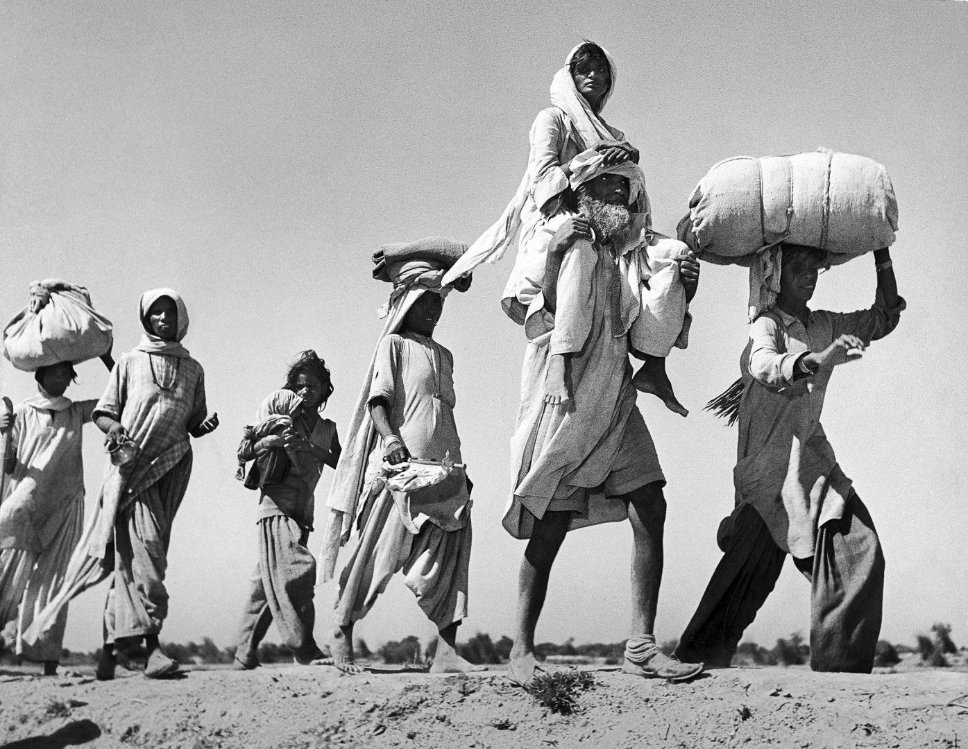 Old Sikh, carrying ailing wife, sets out on the dangerous journey to Indian border