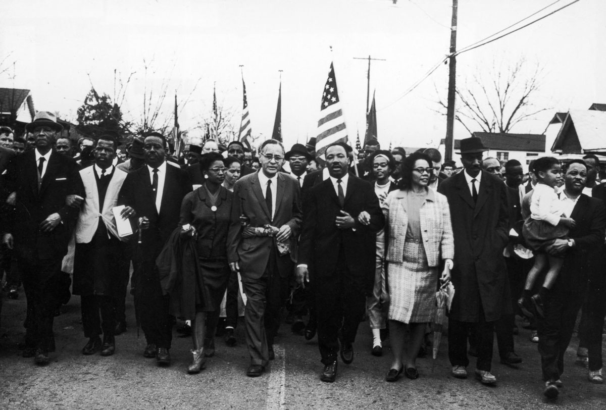 March 28, 1965 - Martin Luther King and 25,000 civil rights protestors end a five-day march at the steps of the state capital of Montgomery in Alabama