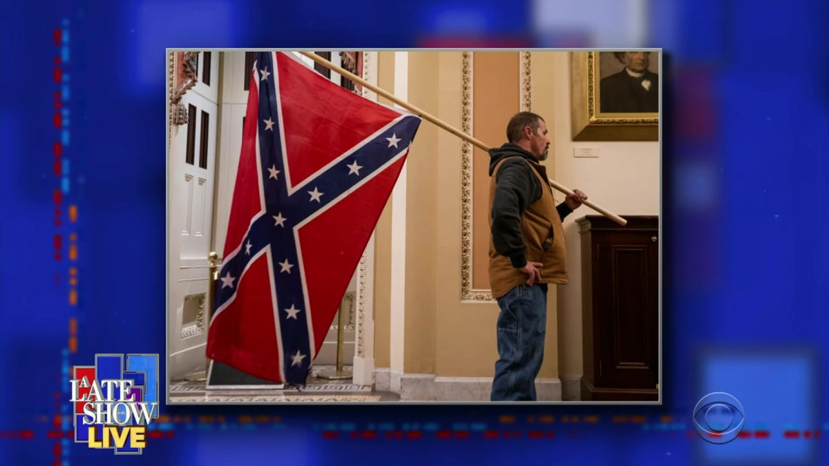 Man holding confederate flag during the assault on Capitol Building